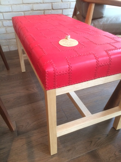 "They've got you covered there too! Hand-stitched 34"" leather bench in red $1,195"