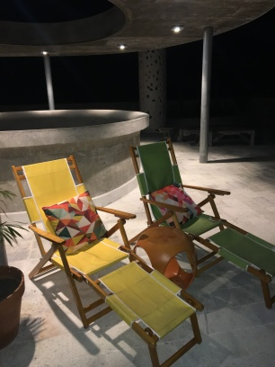 El rooftop patio chaises beside the plunge pool