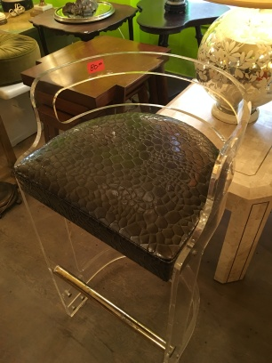This lucite barstool. The last of a set of 12 bought on FirstDibs.